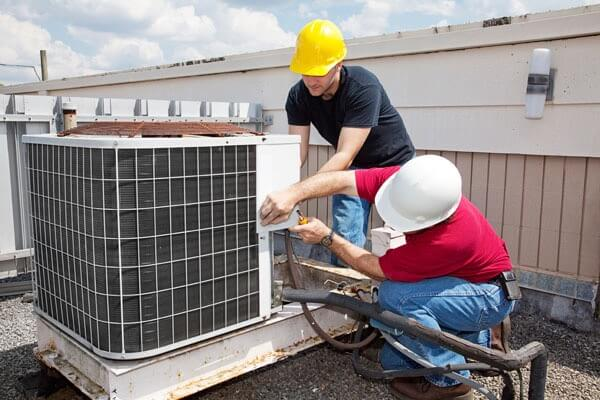 repairing a broken air conditioner